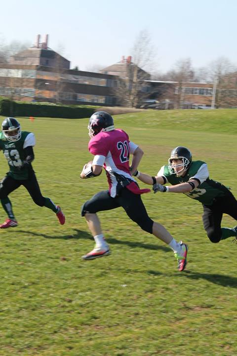Connor Sealy Grabs Cloth to Make the Tackle