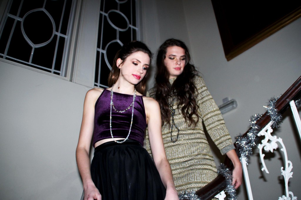 """Emma in 1950's petticoat £35, sparkly long beads  £18, and 1950's paste necklace £18. Clara in """"Midas key"""" 60's shift dress £30, and faux gold & black pearls £15."""
