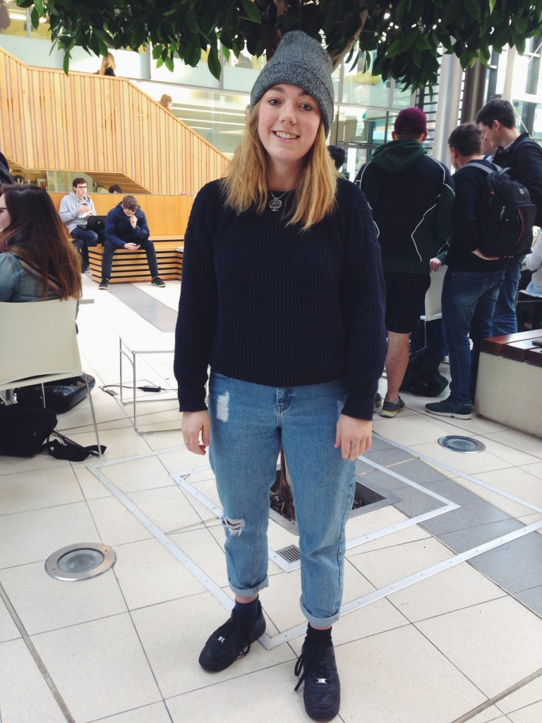 Alice looks cool and comfy with her beanie, jumper and mom jeans ensemble!