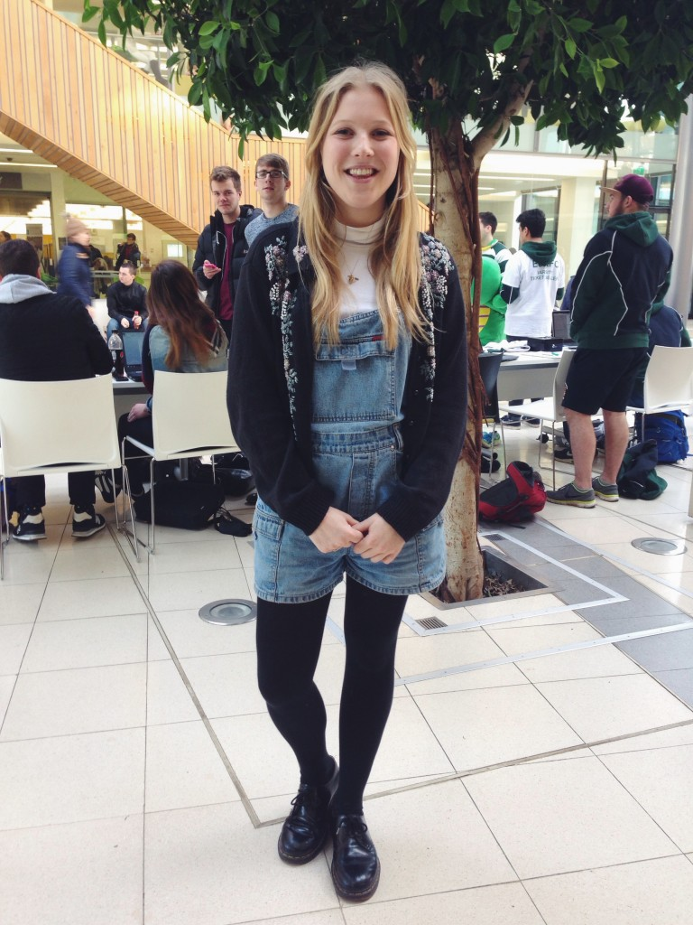 We love how Poppy styles up these denim dungarees with a turtle neck & vintage cardigan!