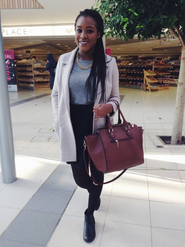 We love Chisom's modern take on the 'schoolgirl' look - who says you can't rock gold chains during daytime?