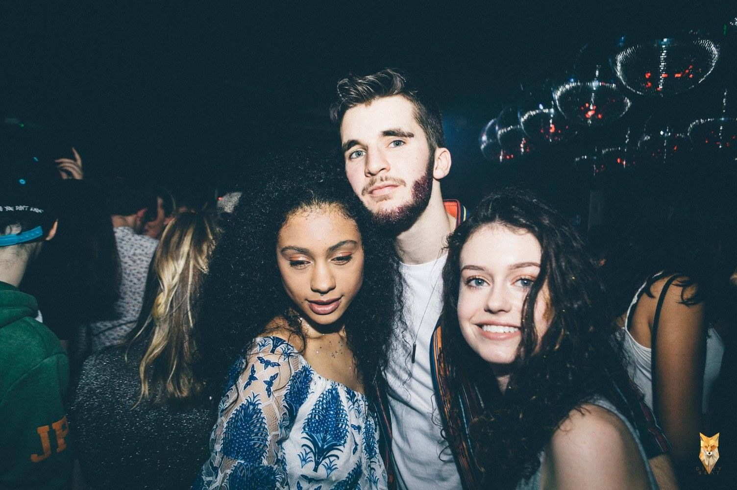 Image may contain: Smile, Portrait, Face, Crowd, Night Life, Night Club, Club, Person, People, Human