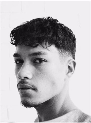 Image may contain: Head, Haircut, Hair, Boy, Human, Face, Person