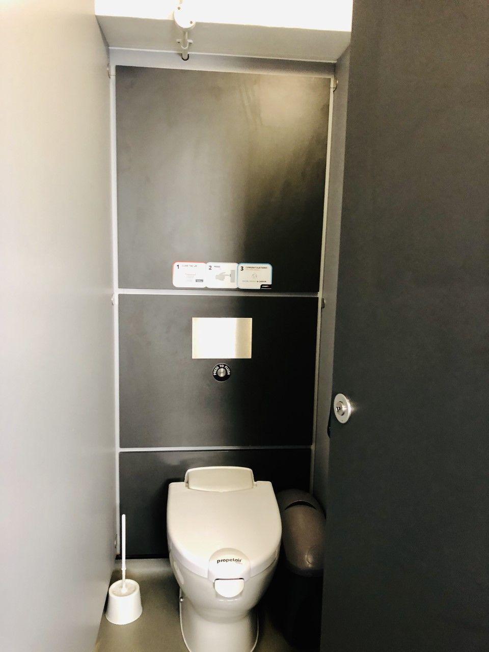 Image may contain: Door, Bathroom, Toilet, Indoors, Room