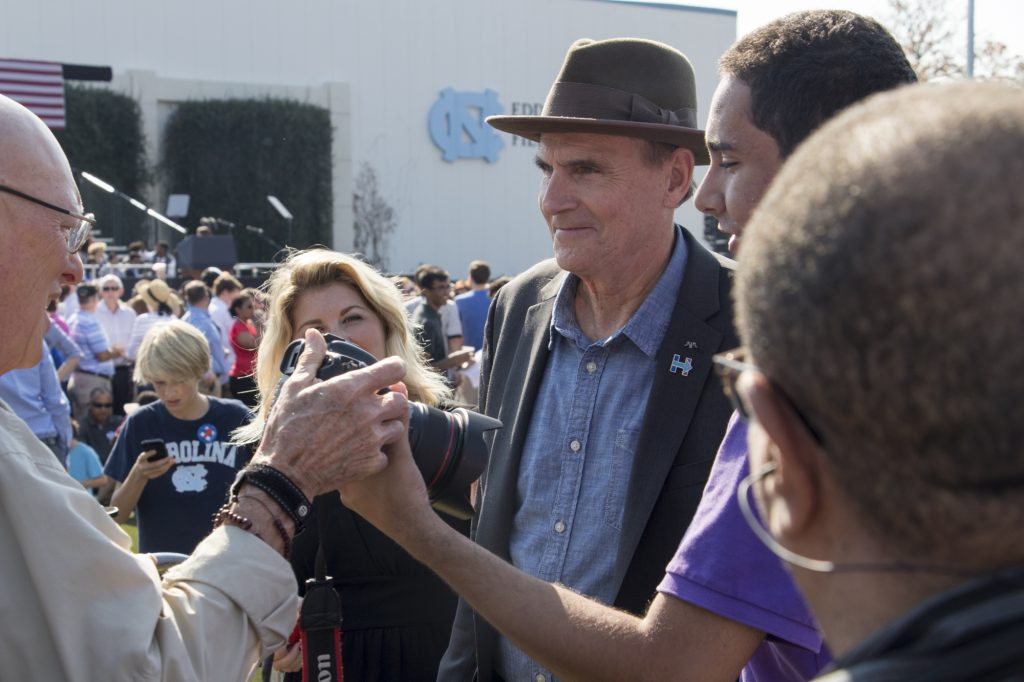 James Taylor and wife, Kim Taylor, speak to press at Obama Rally. Photo: Brenna Elmore / The Tab
