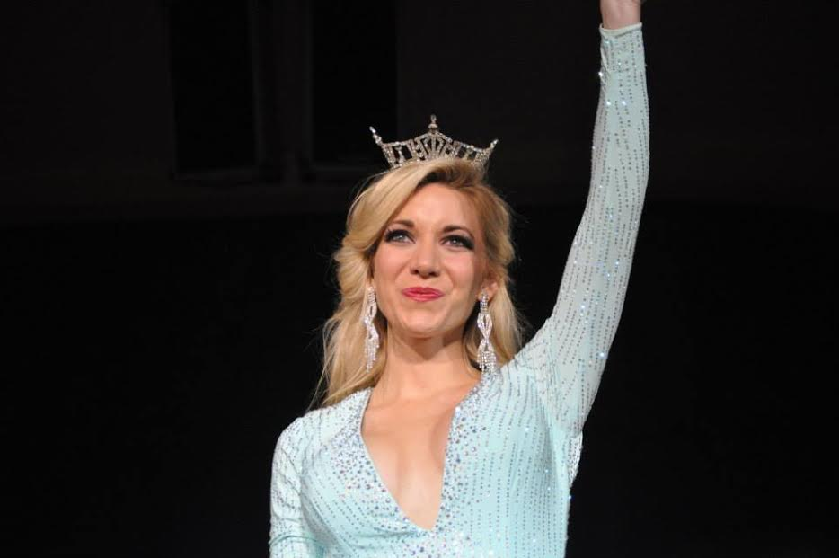 wearing crown blue dress