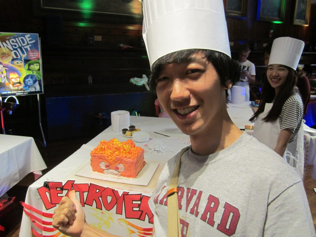 Yu at a cake making event hosted by HUDS for the summer school