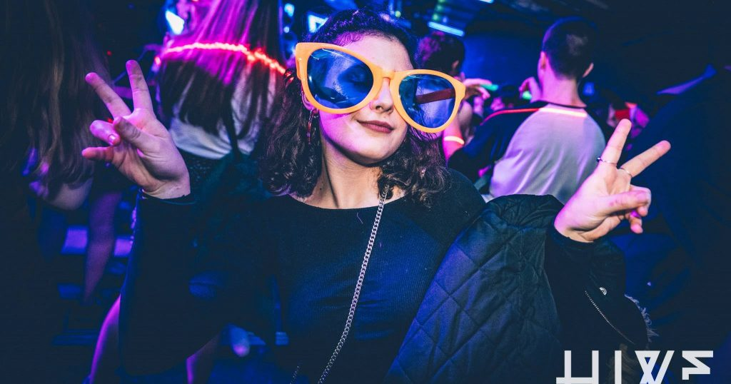 Image may contain: Glasses, Leisure Activities, Night Club, Club, Human, Person, Accessories, Sunglasses, Accessory, Night Life
