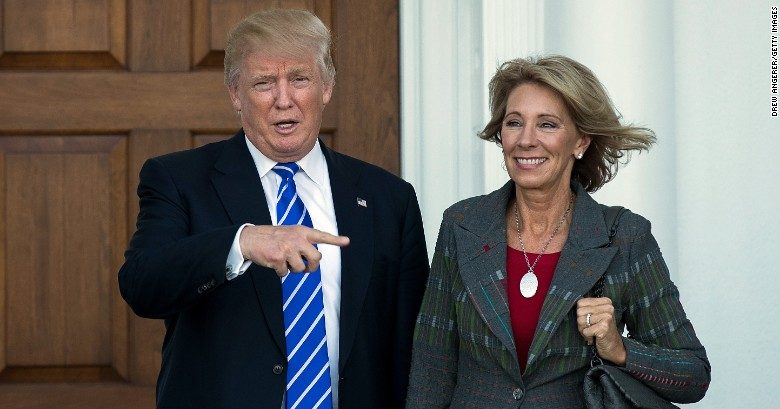President Donald Trump (left), with Secretary of Education, Betsy DeVos (right).