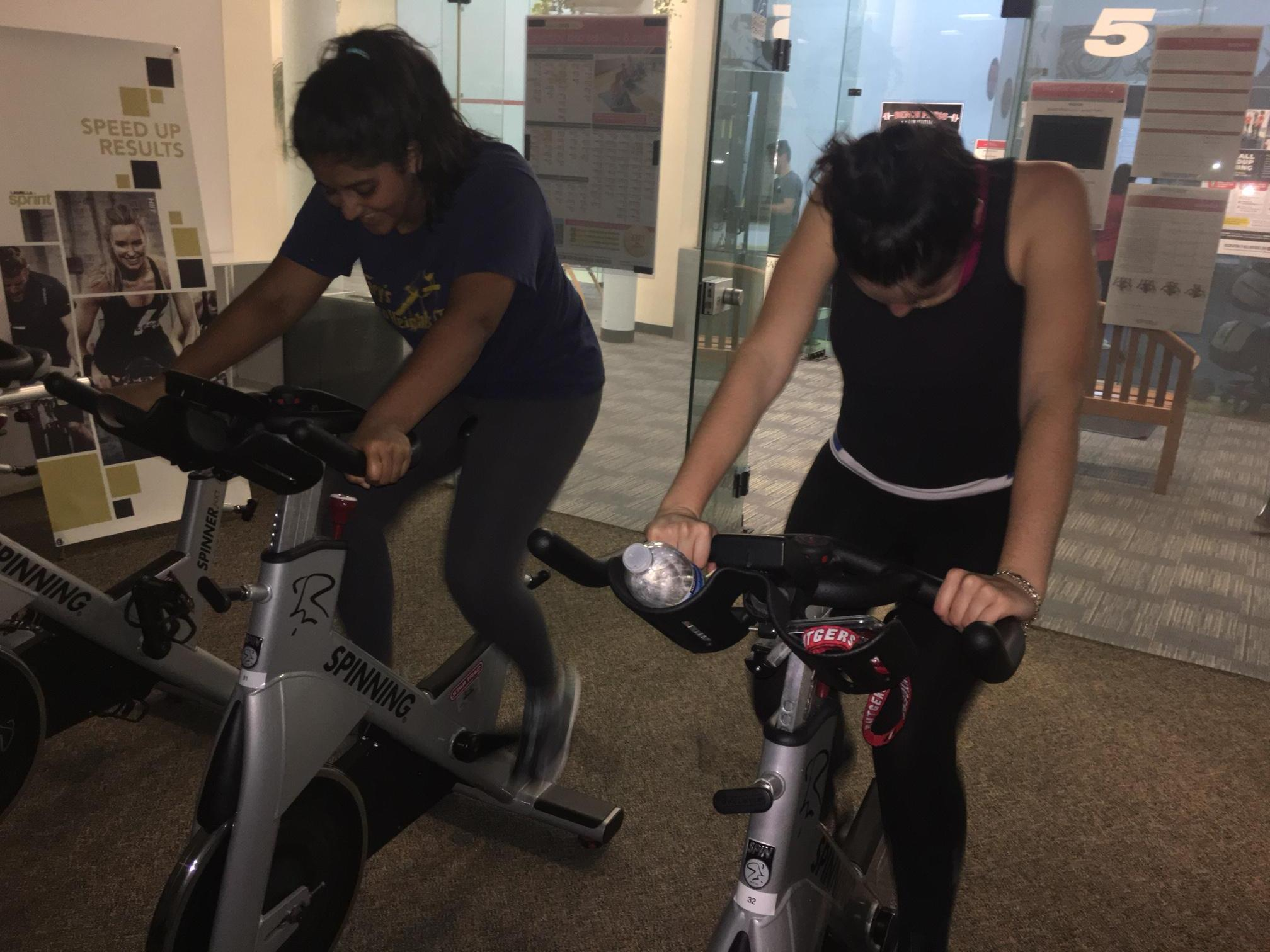 Two spin class lovers trying to go for the gold.