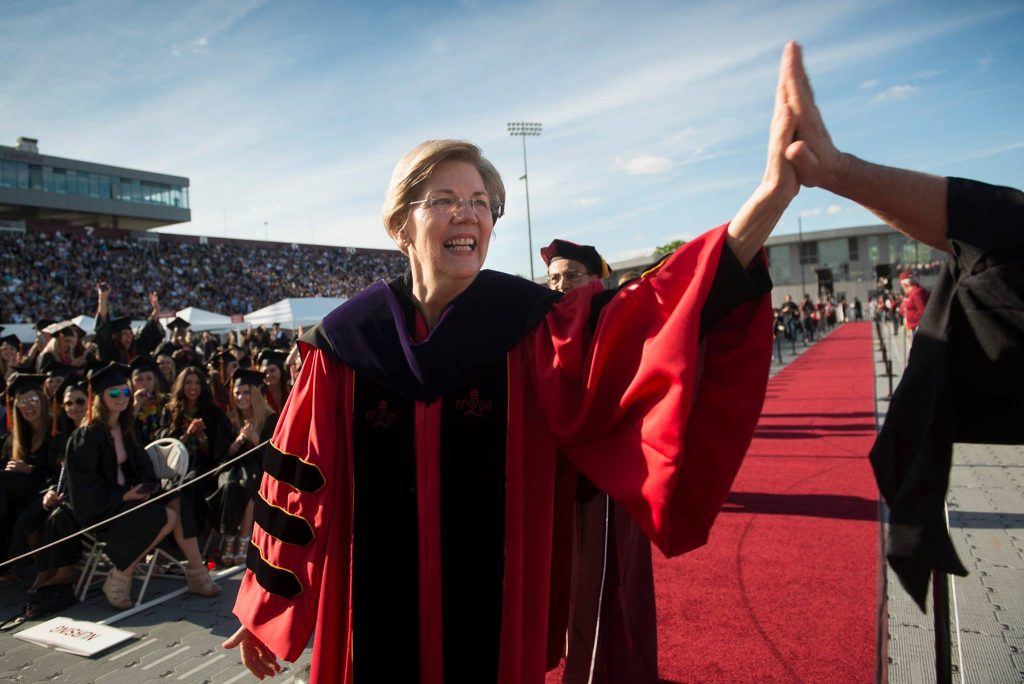 Elizabeth Warren giving a high five at UMass Commencement May 2017