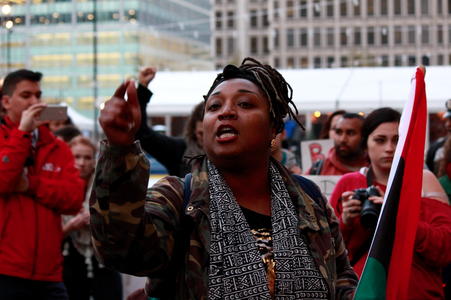 A Black Lives Matter protester speaking after the Million Student March