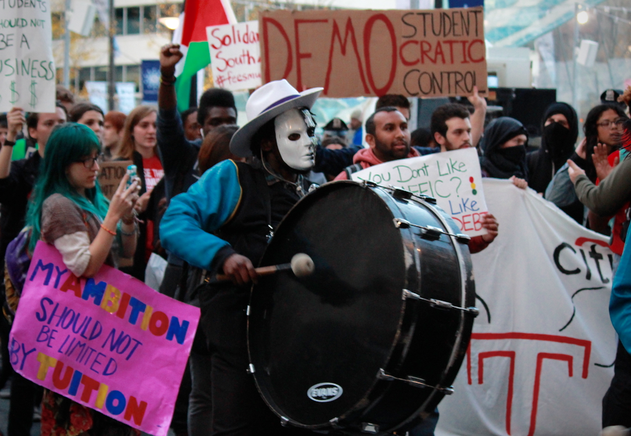 Three masked drummers signaled the arrival of Temple's group of protesters.