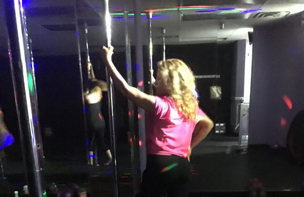 My mother trying out the Pole Fitness class
