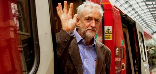 Jeremy Corbyn waves from a train