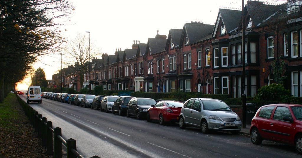 Image may contain: Sedan, Parking Lot, Parking, Vehicle, Transportation, Car, Automobile