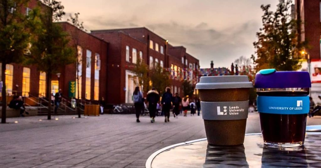 Image may contain: Architecture, Coffee Cup, Cup, Road, Street, Pedestrian, Beverage, Alcohol, Drink, Beer, City, Downtown, Town, Building, Urban, Human, Person