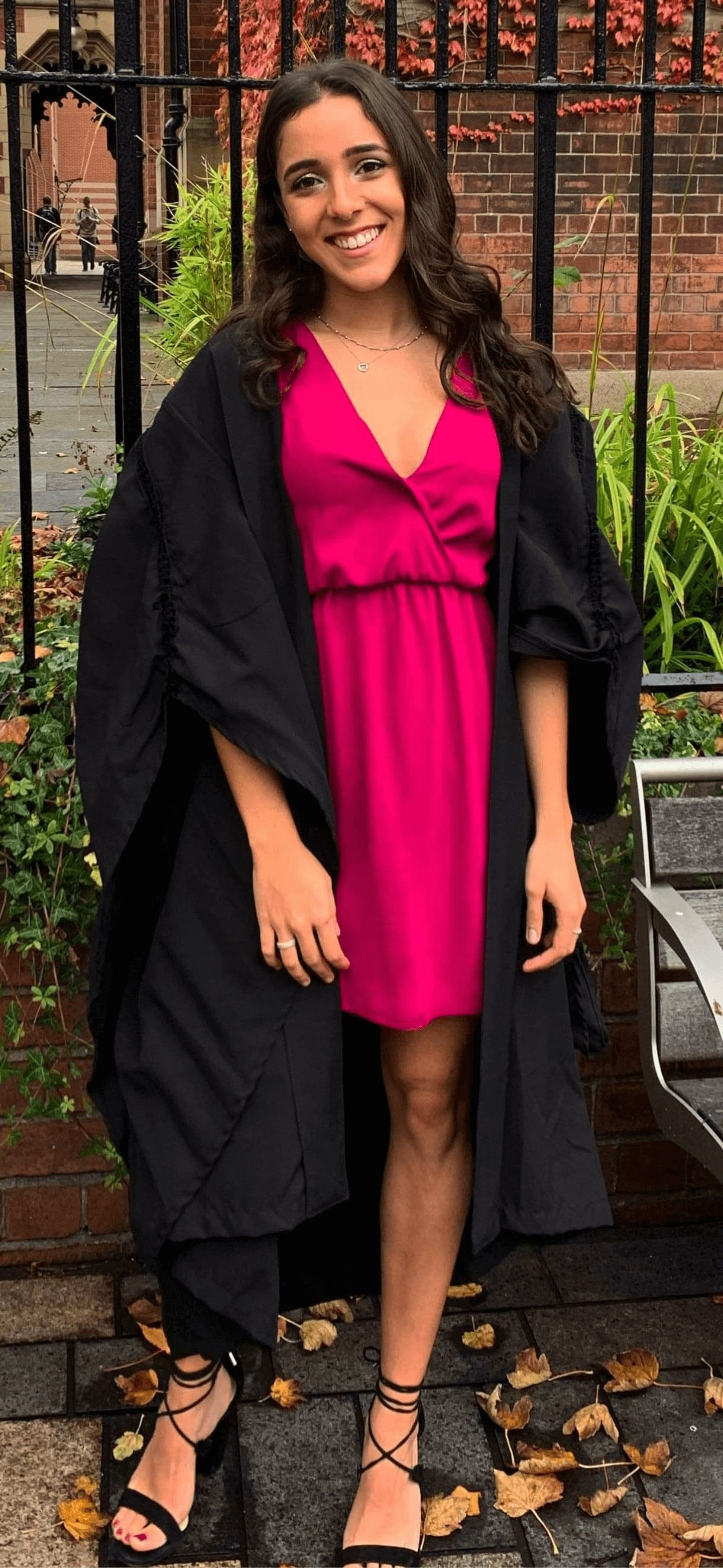 Image may contain: Graduation, Plant, Coat, Overcoat, Woman, Female, Fashion, Dress, Human, Person, Apparel, Clothing