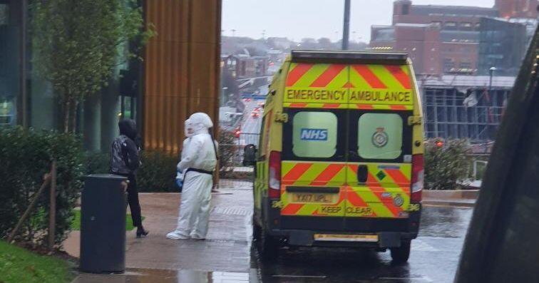 Image may contain: Truck, Vehicle, Transportation, Ambulance, Van, Person, Human