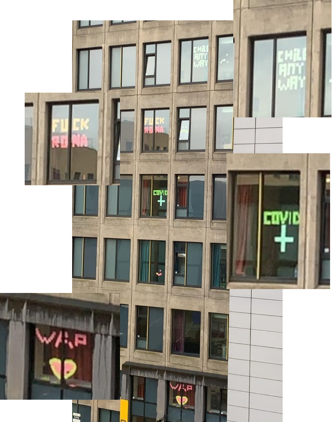 A photo of several windows in Central Village displaying post-it note messages