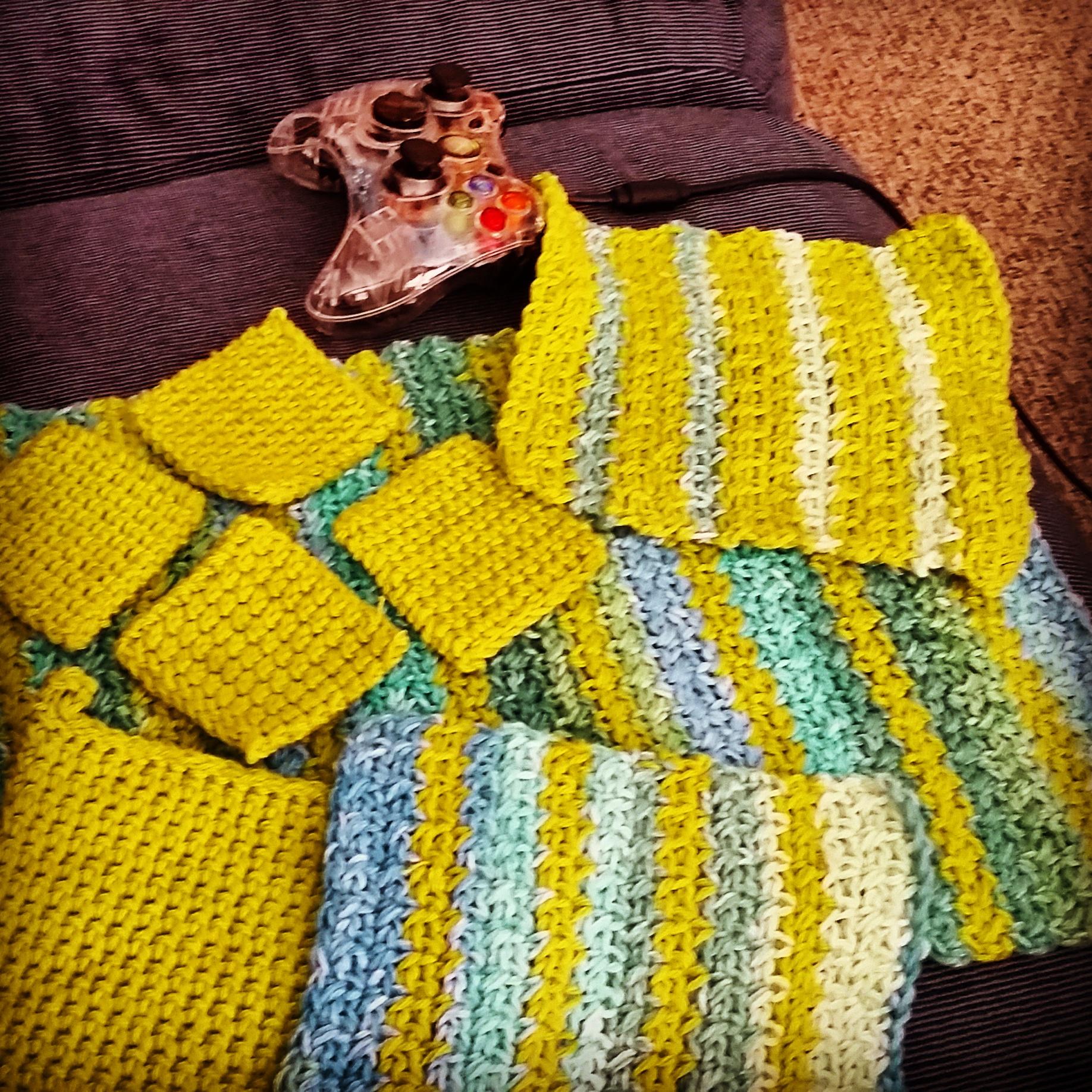 A set of 4 coasters, 2 wash cloths, a dish towel, and a pot holder I made.