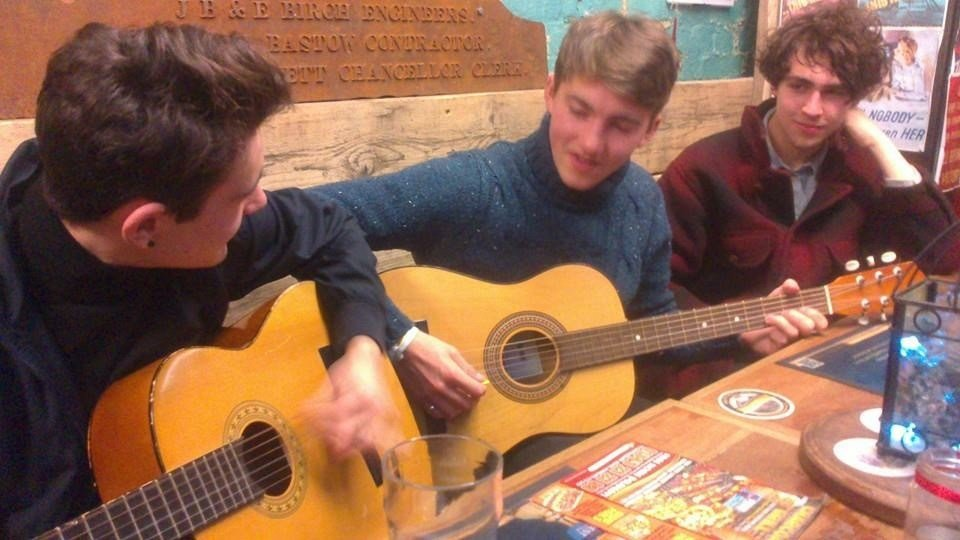 The place where playing guitars in small pubs is standard