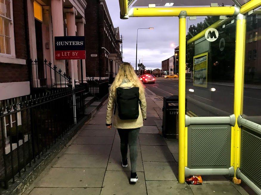 Image may contain: Handrail, Banister, Vehicle, Transportation, Train, Walkway, Sidewalk, Pavement, Path, Person, People, Human