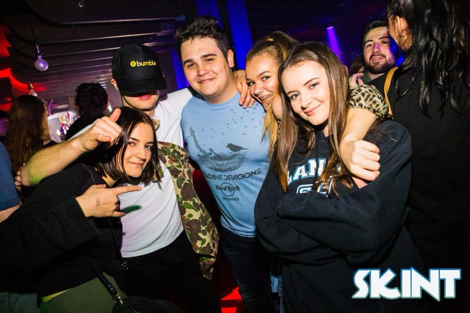 Image may contain: Night Club, Clothing, Apparel, Hat, Club, Party, Human, Person