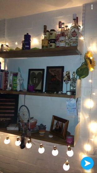 Image may contain: Interior Design, Room, Indoors, Shelf, Furniture