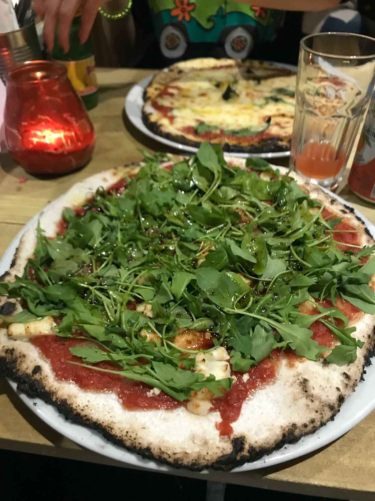 Image may contain: Arugula, Vegetable, Produce, Plant, Pizza, Food