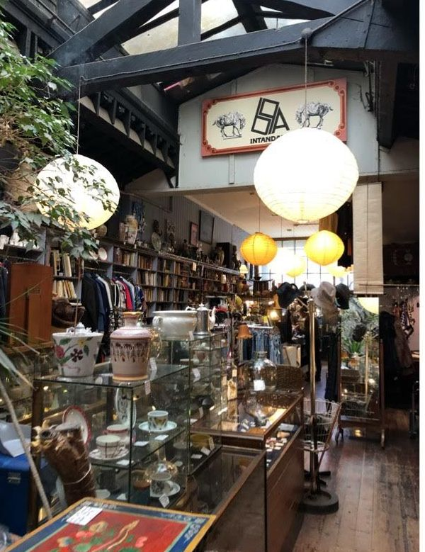 Image may contain: Shelf, Bazaar, Market, Shop, Clothing, Apparel