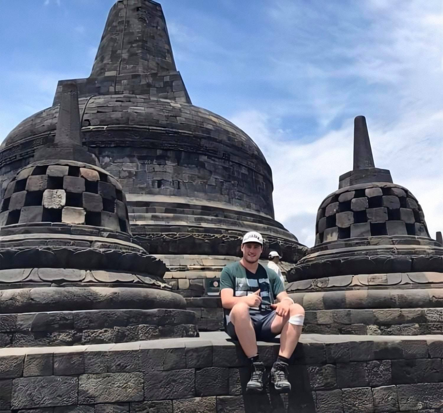 Image may contain: Portrait, Photo, Photography, Monument, Worship, Shrine, Face, Pants, Shorts, Vacation, Temple, Building, Architecture, Shoe, Footwear, Rock, Clothing, Apparel, Person, Human