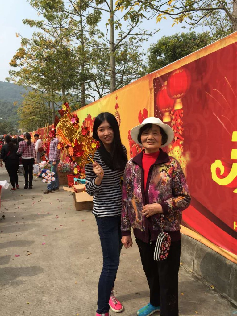 Me and my grandmother at the Flower Fair. A shirt and jeans is enough for the winter.