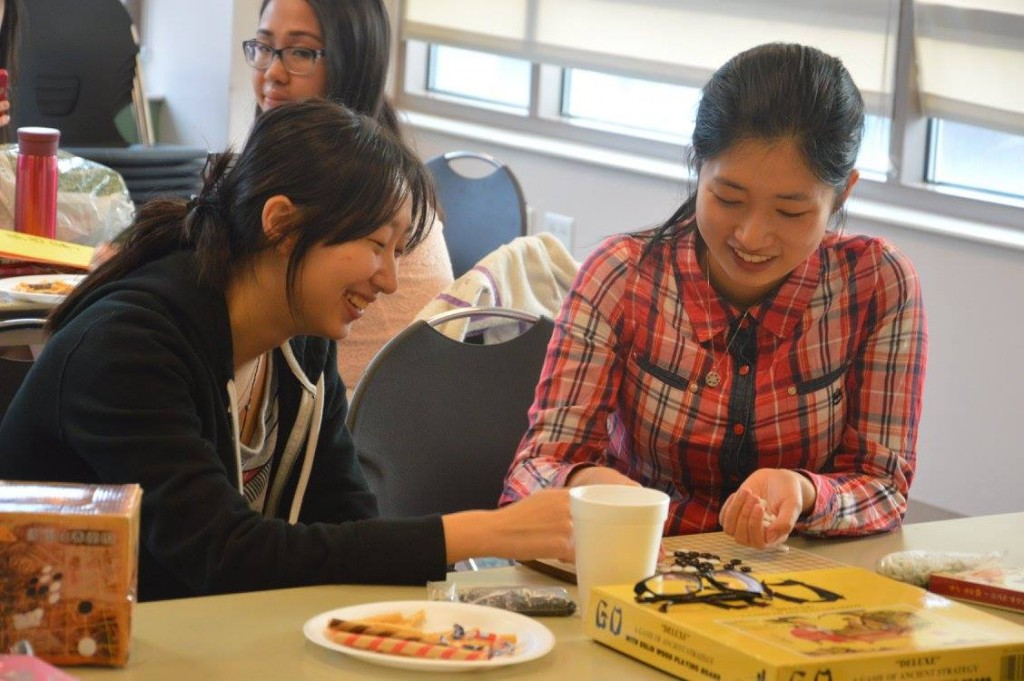 Playing Five in a Row, a traditional Eastern Asian board game, with my friend at a VUCA GBM.