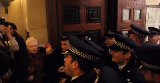 Argy bargy... police pile into Senate House