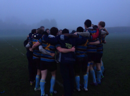 RUMS Rugby men celebrating a win in the lovely British weather.
