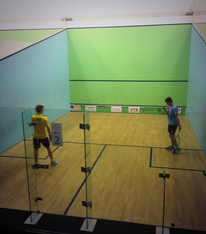 A UC player celebrating a win over former top 30 world player Chris Ryder. (Photo from @UCLUSquashClub)