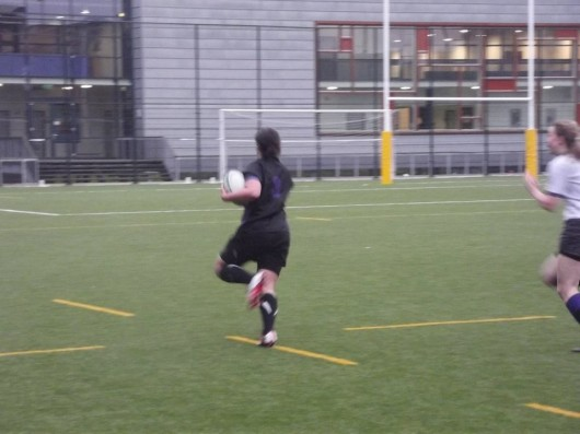 Eleanor sprinting down the pitch during International Tour to Amsterdam.
