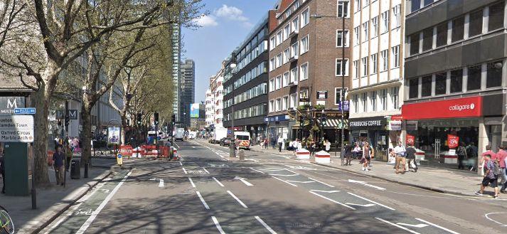 Image may contain: High Rise, Metropolis, Downtown, Tarmac, Asphalt, Intersection, Urban, Building, Street, Town, City, Person, Pedestrian, Human, Road