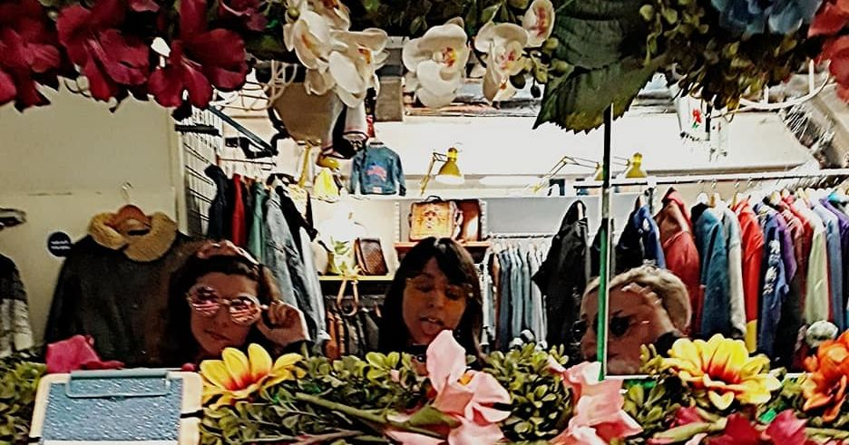 Image may contain: Glasses, Accessory, Accessories, Clothing, Apparel, Indoors, Flower, Blossom, Furniture, Market, Bazaar, Plant, Person, Human, Shop