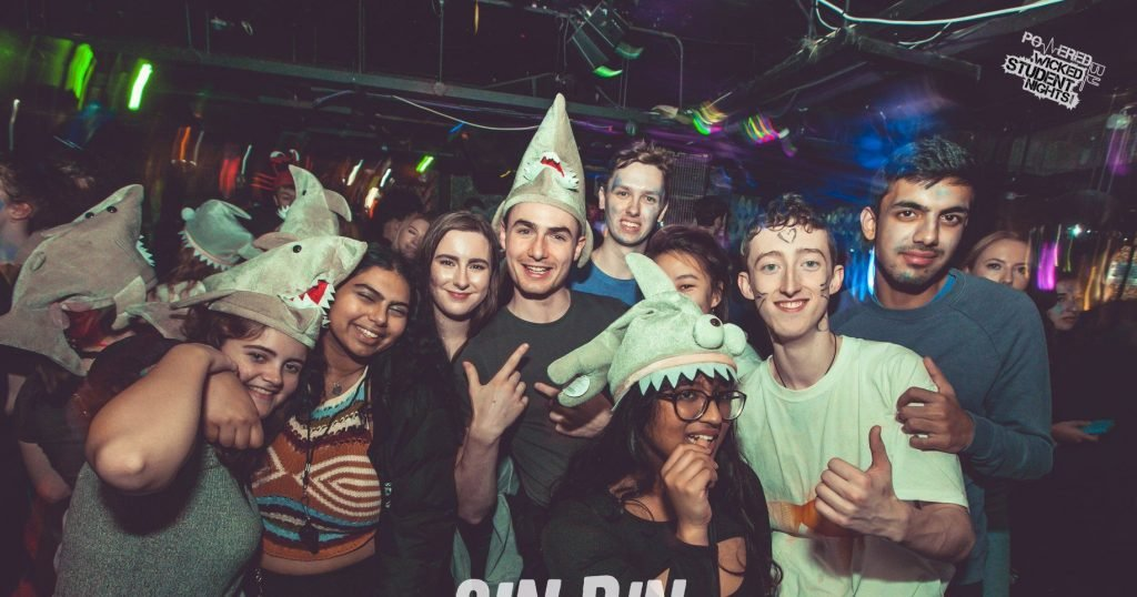 Image may contain: Apparel, Hat, Clothing, Night Club, Club, Party, Human, Person