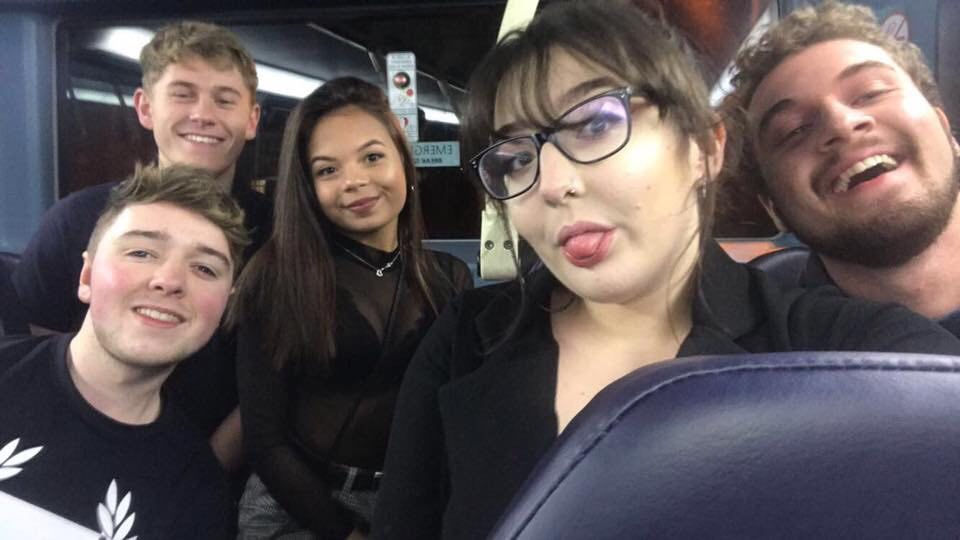 Five people in a bus on the way to the club