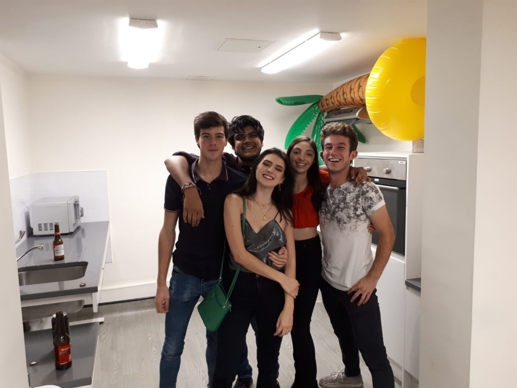 Five people in a kitchen for pres
