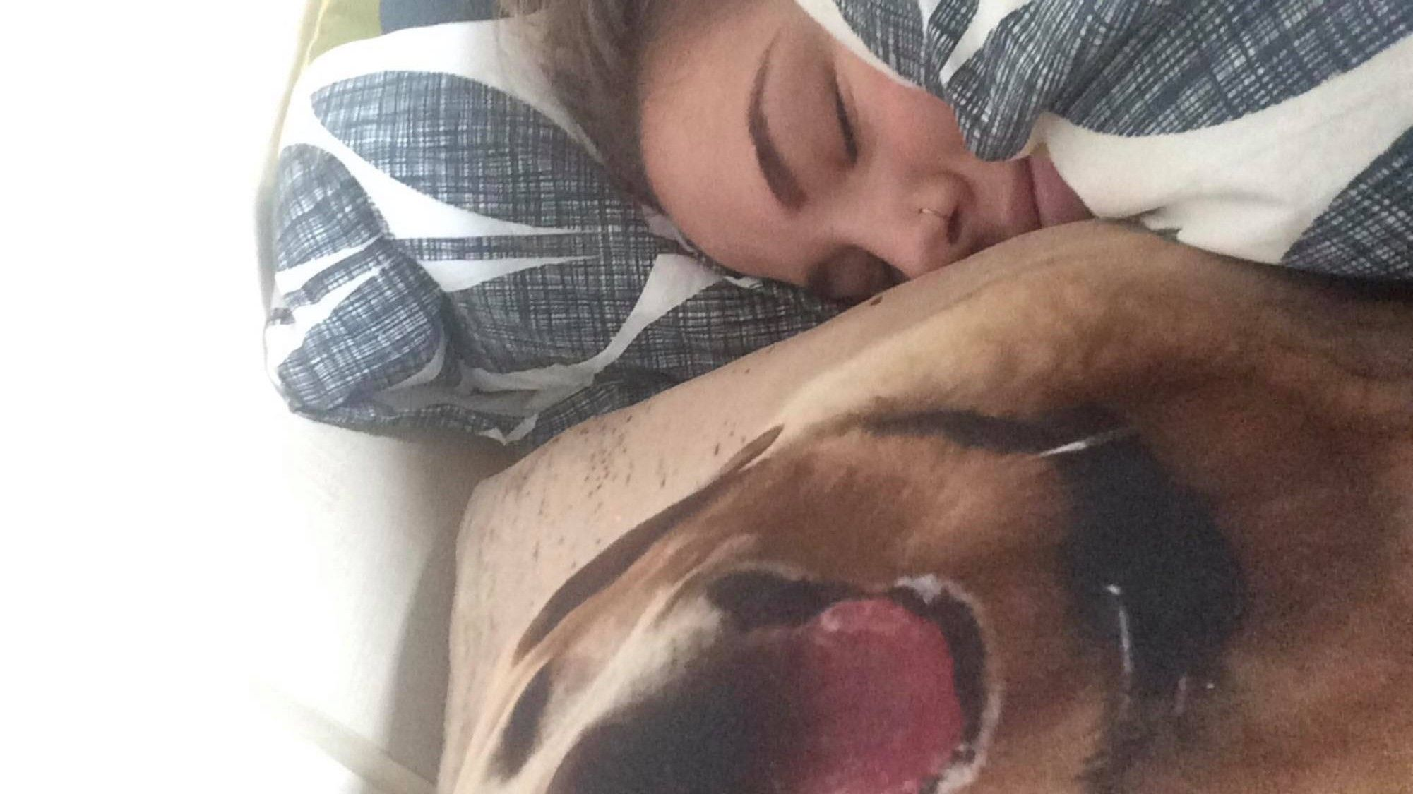 Image may contain: Blanket, Home Decor, Person, Human, Skin, Asleep, Sleeping, Cushion, Pillow
