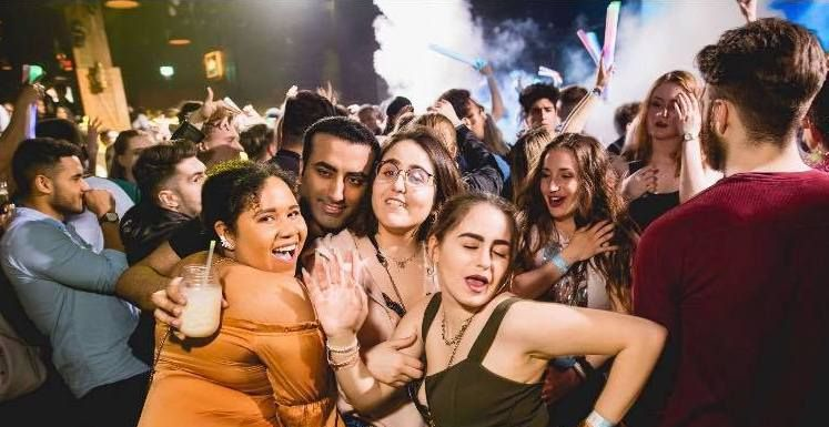 Image may contain: Photo, Portrait, Photography, People, Crowd, Spring Break, Face, Tourist, Vacation, Party, Night Life, Person, Human
