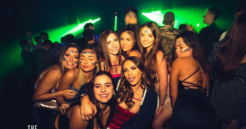 Image may contain: Disco, Night Life, Night Club, Club, Human, Person, Party