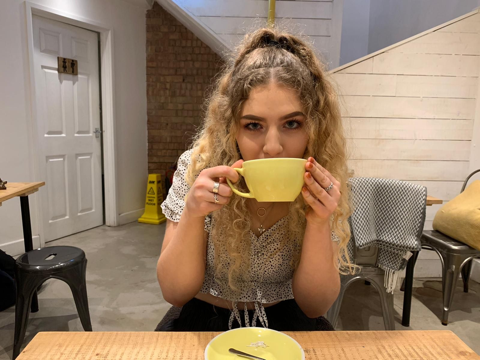 Image may contain: Coffee Cup, Cup, Bowl, Hardwood, Home Decor, Chair, Furniture, Plywood, Person, Human, Wood