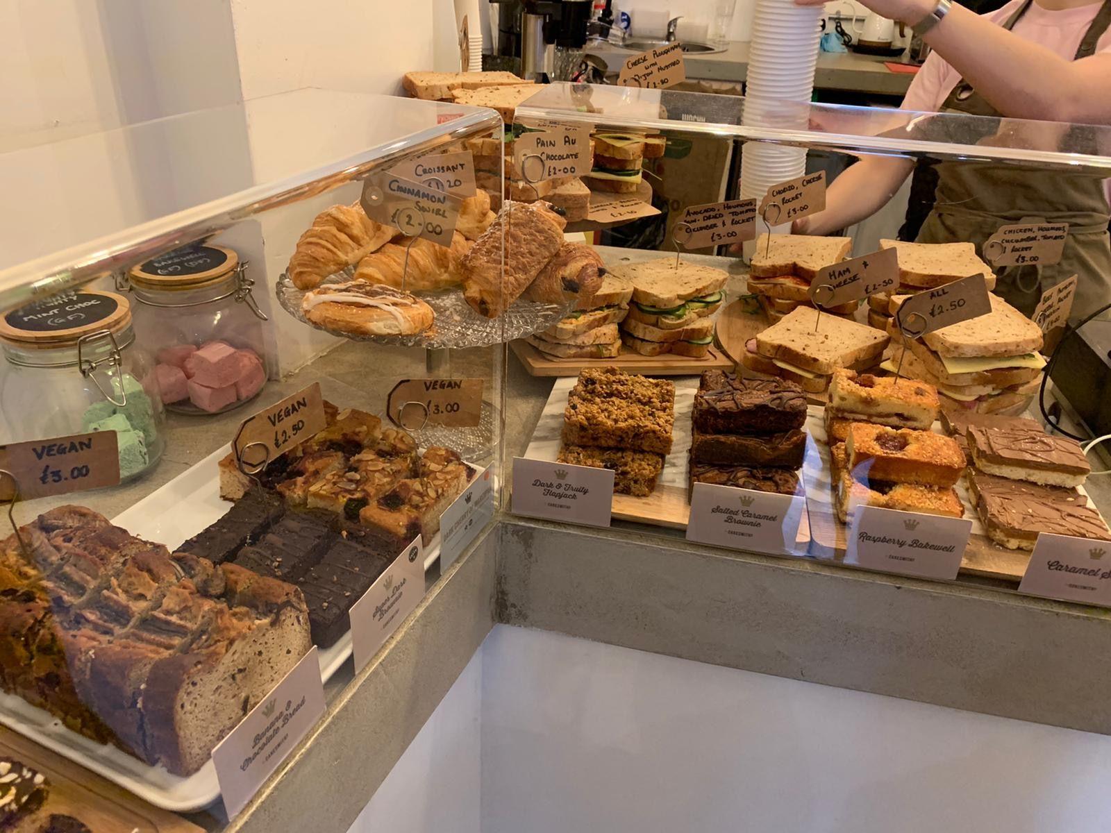 Image may contain: Food, Person, Human, Bakery, Shop