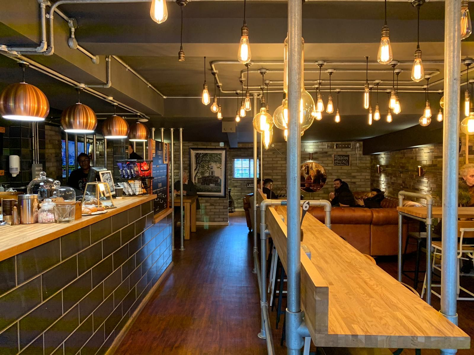 Image may contain: Meal, Food, Cafe, Cafeteria, Hardwood, Plywood, Human, Person, Restaurant, Wood