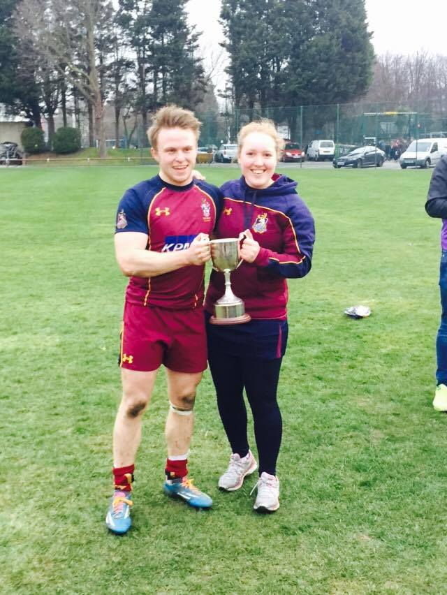 Champion: Katie Lightowler (right) proudly holds the Varsity trophy